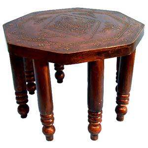 Eight legged embossed table